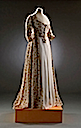 1793-1797 Long cream dress with open front skirt panel showing white underskirt cotton (Bath Fashion Museum - Bath, Somerset UK)