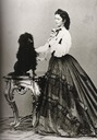 1864 Empress Elizabeth playing with a dog