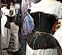 "1875 Corset cuirasse en satin noir, comportant 34 baleines, porté sur une chemise de jour, avec une tournure en ""queue d'écrevisse"" (""crayfish tail"") (Musée municipal de Vire - Vire, Basse-Normandie France)"