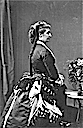 1872 Empress Eugenie wearing a bustle from the side