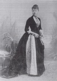 1885 Isabel La Chata in dark second bustle period dress