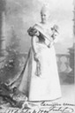 1894 Infanta Isabel Isabel wearing evening dress with A-line skirt