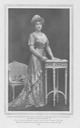 1910 Ena standing wearing a Worth dress