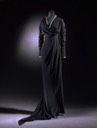 1912 Black silk crepe, edged with bands of black and cream silk, the neck fitted with machine-made black lace by Lucile kristine
