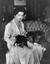 1916 (9 February) Lady Lucy Duff-Gordon, three-quarter length portrait, seated, facing right, with lapdog by Marceau