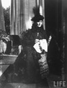 1916 Somber-looking Alexandra Feodorovna, consort of Tsar Nicholas II of Russia, sitting doing needlework a short time after the death of Rasputin