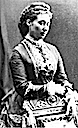 Alice of Hesse upper body photo while she stands behind a chair