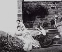 ca. 1863 Lady Frances Jocelyn and her two daughters, Alice and Edith, in the courtyard of White Rock Villa, St Leonards-on Sea, near Hastings - Lady Frances sits on the steps, spinning wool  From photohistory-sussex.co.uk:HastingsJocelyn.htm