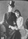 ca. 1876 (estimate based on age of Marie Valerie) Countess Larisch confidante of the Empress and the Crown Prince with Archduchess Marie Valerie, Elisabeth's favourite child From adecorativeaffair.files.wordpress.com:2012:06:img 0372 detint cropped