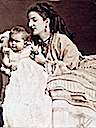 ca. 1870 Margherita wearing coral necklace with baby Vittorio Emanuele III