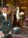 Daisy Countess of Warwick enters the library after a morning of riding