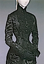 Detail of a dark hourglass figure dress worn by Empress Elisabeth (location unknown to gogm)