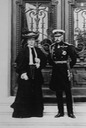 Duke and Duchess of Connaught, standing on steps before elaborate doors