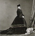 ca. 1865 Elisabeth dressed for the cold in a fur-trimmed paletot by Emil Rabending