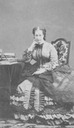 Eugénie seated with lace shawl on her lap