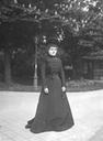 ca. 1908 Eulalia wearing a dark-color dress