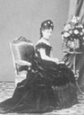 Infanta Isabel seated in dark evening dress