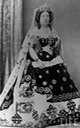Isabel II in court dress, train, and veil