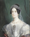 Lady, wearing white dress with jewelled brooch at her corsage, pearl necklace, earring and veil from a jewelled tiara by ? (auctioned by Bonham's)