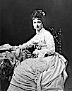 1878 Margharita seated wearing openwork-decorated dress by Fratelli Alessandri