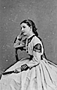 Margherita seated wearing dress adorned with tassels
