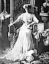 Marie of Romania sitting wearing glitter-banded dress facing forward
