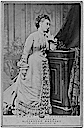 1875 Princess Alice standing wearing a bustle dress by desk, also by Alexander Bassano