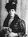 Queen Alexandra wearing a day dress holding small dog