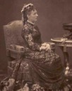 Maria Hendrika seated in lace dress