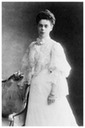 Xenia Alexandrovna standing by a chair