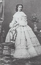 1860 Empress Elisabeth standing behind a chair in her flounced dress